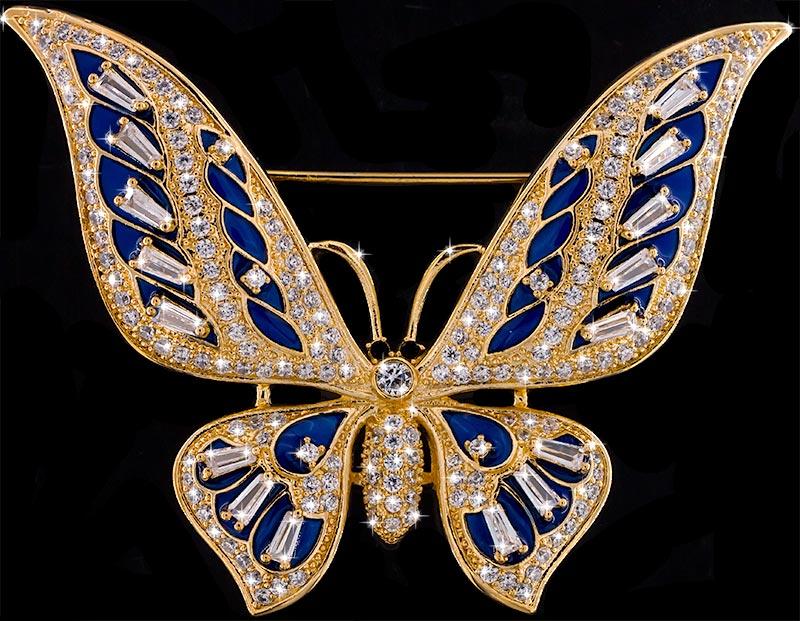 Brosche Schmetterling goldfarben mit blauen Details und vielen weissen Strass Steinen BR056 oben
